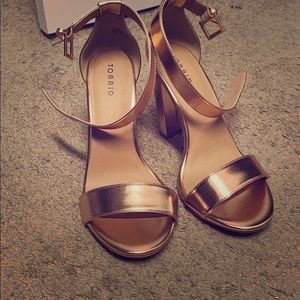 High heel shoes , rose gold